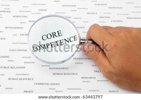 The word CORE COMPETENCE is magnified. - stock photo