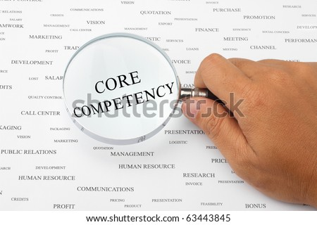 The word CORE COMPETENCY is magnified. - stock photo