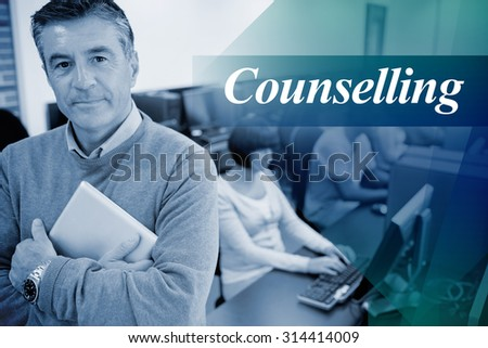The word counselling against teacher standing while holding a tablet pc - stock photo