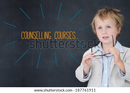 The word counselling courses against schoolboy and blackboard - stock photo