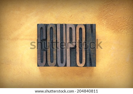 The word COUPON written in vintage letterpress type - stock photo