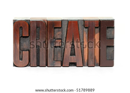 The word Create in old wooden letterpress type - isolated on white background - stock photo