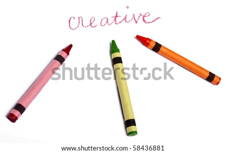 The Word Creative Handwritten with Several Vibrant colored Crayons on White. - stock photo