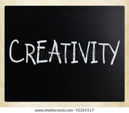 "The word ""Creativity"" handwritten with white chalk on a blackboard - stock photo"