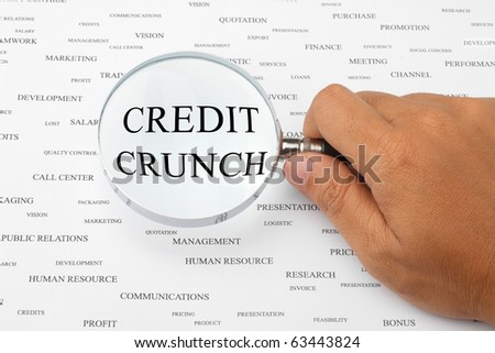 The word CREDIT CRUNCH is magnified. - stock photo