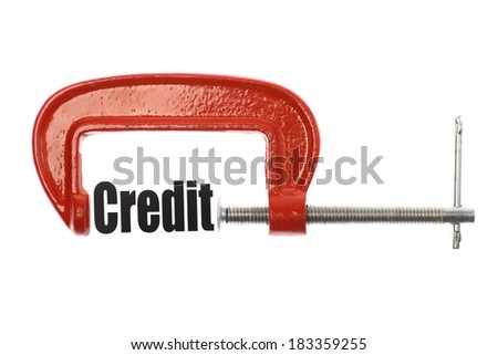 "The word ""Credit"" is compressed with a vice. Business metaphor. - stock photo"