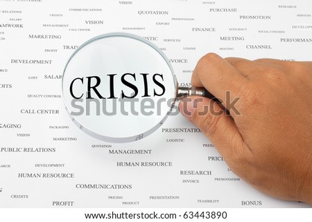 The word CRISIS is magnified.