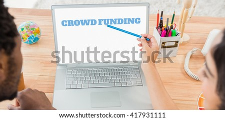 The word crowdfunding against white background against colleagues brainstorming and pointing laptop screen