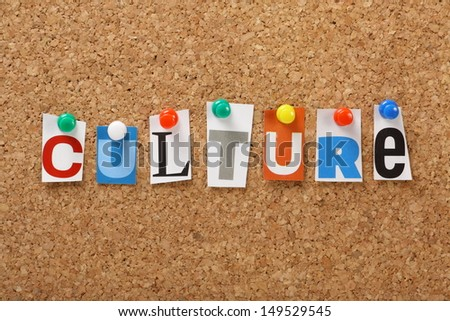 The word Culture in cut out magazine letters pinned to a cork board. Culture may refer to art or literature but also means the upkeep of tradition and often unique society values and beliefs.
