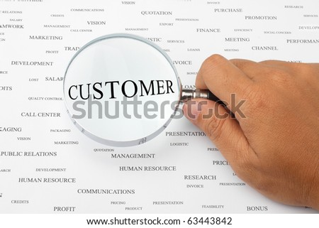 The word CUSTOMER is magnified. - stock photo