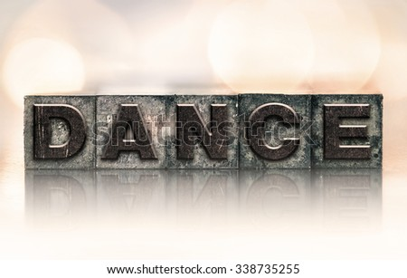 "The word ""DANCE"" written in vintage ink stained letterpress type."