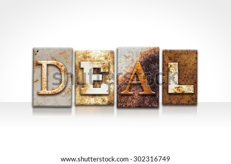 """The word """"DEAL"""" written in rusty metal letterpress type isolated on a white background. - stock photo"""