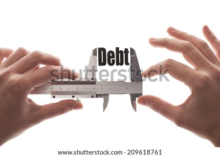 """The word """"Debt"""" is measured with a caliper. Business metaphor. - stock photo"""