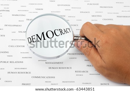 The word DEMOCRACY is magnified.