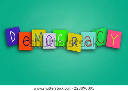 The word Democracy written on sticky colored paper - stock photo