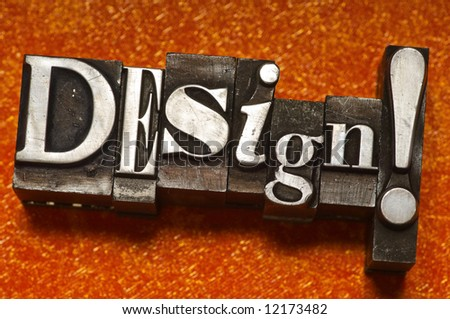 "The word ""Design"" done in old letterpress type. - stock photo"