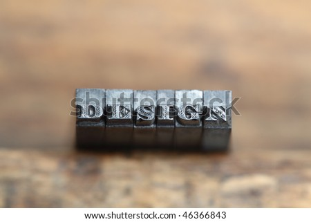the word design in letterpress type on a wooden background. - stock photo