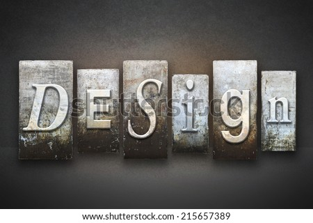 The word DESIGN written in vintage letterpress type - stock photo