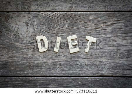 The word diet on the wooden floor - stock photo