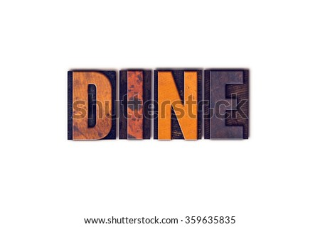 """The word """"Dine"""" written in isolated vintage wooden letterpress type on a white background. - stock photo"""