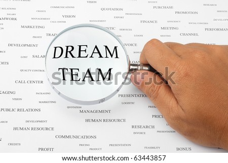 The word DREAM TEAM is magnified. - stock photo