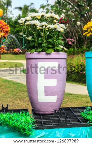 The Word E on violet flowerpot in tulips park.