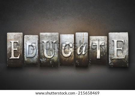 The word EDUCATE written in vintage letterpress type - stock photo