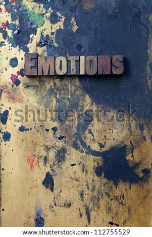 The word Emotions written in antique letterpress printing blocks. - stock photo