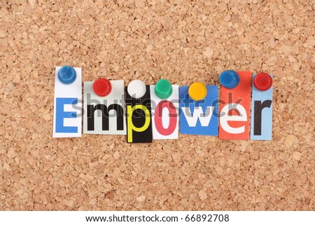 The word Empower in cut out magazine letters pinned to a cork notice board