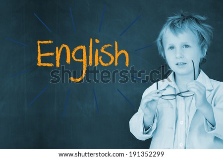 The word english against schoolboy and blackboard - stock photo