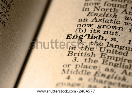 The word English. Close-up of the word English in a dictionary. - stock photo
