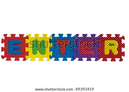"The word ""Enter"" written with alphabet puzzle letters isolated on white background"
