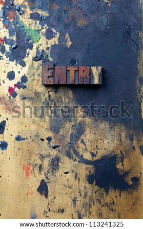 The word entry written in antique letterpress printing blocks. - stock photo