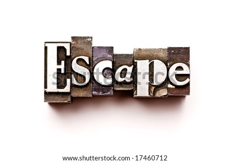 The word Escape photographed using vintage letterpress type