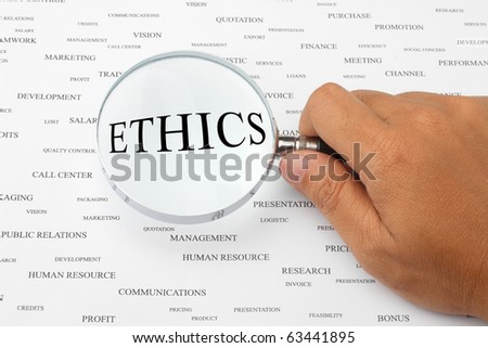 The word ETHICS is magnified. - stock photo