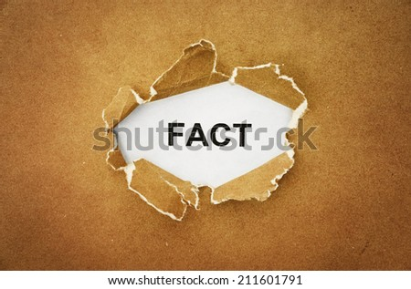 "the word ""fact"" in the hole of brown paper - stock photo"