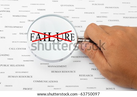 The word FAILURE with red cross in magnifying glass.