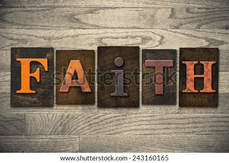 """The word """"FAITH"""" written in wooden letterpress type. - stock photo"""