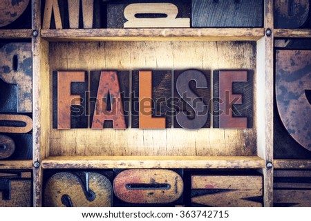 "The word ""False"" written in vintage wooden letterpress type."
