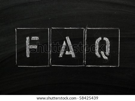 The word FAQ in stencil letters on a blackboard - stock photo