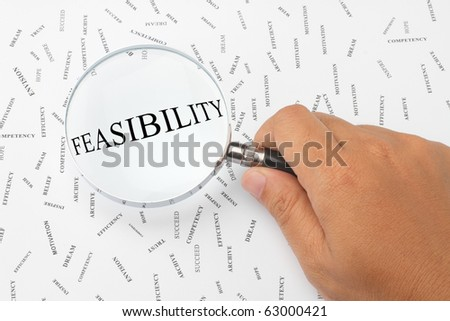 The word, FEASIBILITY is magnified. - stock photo