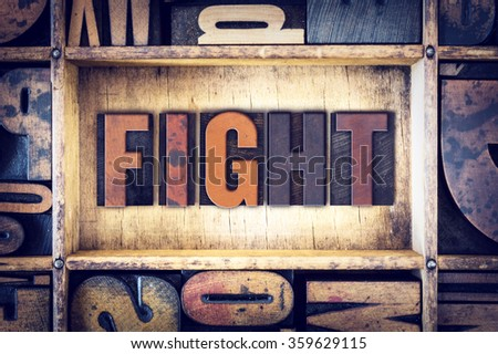 "The word ""Fight"" written in vintage wooden letterpress type."