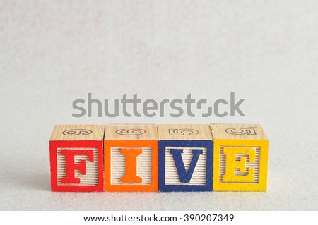 The word five (5) spelled with colorful alphabet blocks isolated against a white background - stock photo