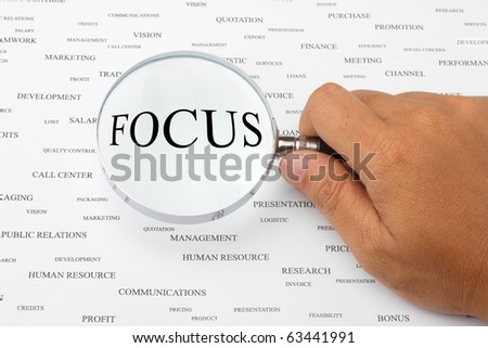 The word FOCUS is magnified. - stock photo