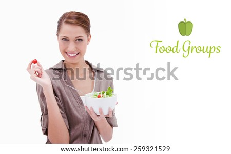 The word food groups against woman with bowl of salad and small tomato in her fingers - stock photo