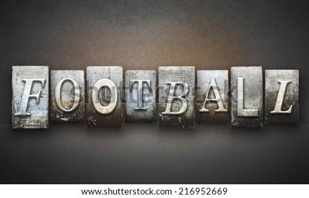 The word FOOTBALL written in vintage letterpress type - stock photo