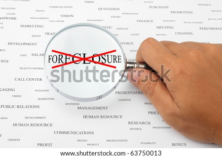 The word FORECLOSURE with red cross in magnifying glass. - stock photo