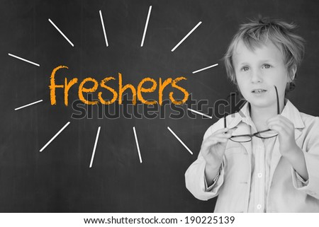 The word freshers against schoolboy and blackboard - stock photo
