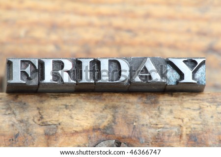 the word friday in letterpress type on a wooden background. - stock photo