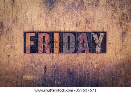 """The word """"Friday"""" written in dirty vintage letterpress type on a aged wooden background. - stock photo"""